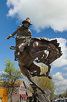 Bronze sculpture of cowboy riding buckinbg bronco, Joseph Oregon