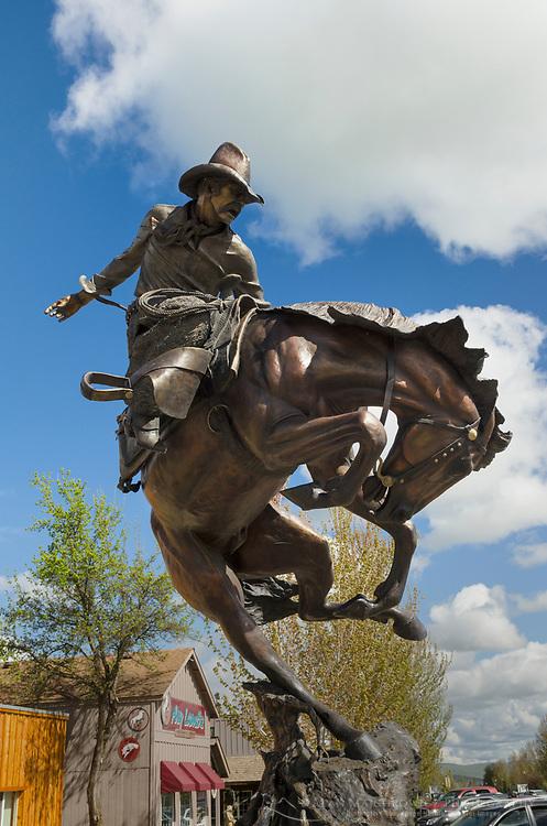 Bronze sculpture of cowboy riding buckinbg bronco, Joseph Oregon