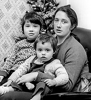 """Lilian Hannaway, Belfast, N Ireland, with her children, Liam (4) and Tracey (2), pictured in her Belfast, N Ireland, home, 13th December 1973. This will be the third Christmas her husband, Kevin Hannaway, will spend as an internee in the Maze Prison, N Ireland. Her husband has been referred to as a """"top IRA man"""" by the British Army's Major General Tony Farrar-Hockley. 197312130765<br /> <br /> Copyright Image from Victor Patterson, 54 Dorchester Park, <br /> Belfast, UK, BT9 6RJ<br /> <br /> t1: +44 28 9066 1296 (from Rep of Ireland 048 9066 1296)<br /> t2: +44 28 9002 2446 (from Rep of Ireland 048 9002 2446)<br /> m: +44 7802 353836<br /> <br /> e1: victorpatterson@me.com<br /> e2: victorpatterson@gmail.com<br /> <br /> www.victorpatterson.com<br /> <br /> Please see my Terms and Conditions of Use at VICTORPATTERSON.COM. It is IMPORTANT that you familiarise yourself with them.<br /> <br /> Images used on the Internet must be visibly watermarked i.e. ©VICTORPATTERSON.COM within the body of the image and copyright metadata must not be deleted. Images used on the Internet have a size restriction of 4kbs and are chargeable at the then current NUJ rates.<br /> <br /> This image is only available for the use of the download recipient i.e. television station, newspaper, magazine, book publisher, etc, and must not be passed on to any third party. It is also downloaded on condition that each and every usage is notified within 7 days to victorpatterson@me.com<br /> <br /> The right of Victor Patterson to be identified as the author is asserted in accordance with The Copyright Designs And Patents Act (1988)."""
