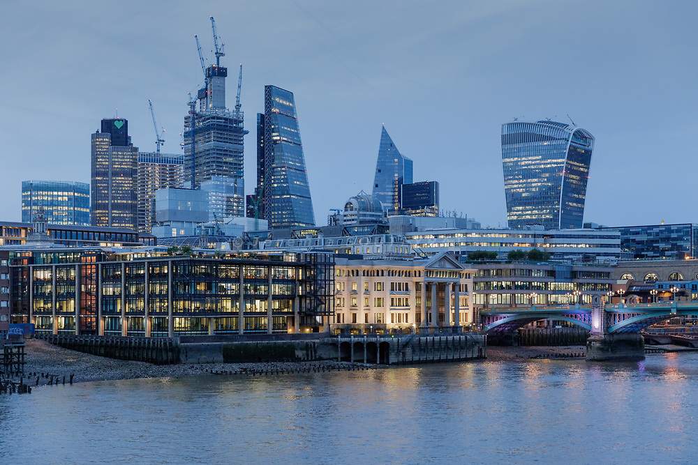 London, England, UK, June 15 2018 - Skyscrapers of the City and Thames River as seen from the south bank of the river.