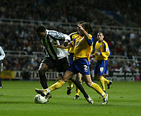 Photo: Andrew Unwin.<br />Newcastle United v Southampton. The FA Cup. 18/02/2006.<br />Newcastle's Shola Ameobi (L) is tackled by Southampton's Alexander Ostlund (R).
