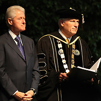 President Bill Clinton stands with UCF President John Hitt  during UCF's College of Health and Public Affairs and the College of Medicine's Burnett School of Biomedical Sciences Commencement ceremony at the UCF Arena on Thursday, May 2, 2013 in Orlando, Florida.   (AP Photo/Alex Menendez)