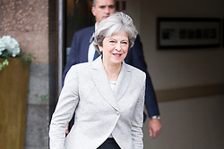 © Licensed to London News Pictures. 01/10/2017. Manchester UK. Prime Minister Theresa May leaves the Midland hotel this morning on the first day of the Conservative Party Conference at the Midland Hotel & Manchester Central. Photo credit: Andrew McCaren/LNP