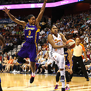 Alex Bentley, Connecticut Sun, drives to the basket past Alana Beard, Los Angeles Sparks, during the Connecticut Sun Vs Los Angeles Sparks WNBA regular season game at Mohegan Sun Arena, Uncasville, Connecticut, USA. 3rd July 2014. Photo Tim Clayton
