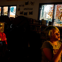Olivia Nielson takes a turn at the karaoke station during the Tobe Turpen Elementary Fall Festival Thursday in Mentmore.