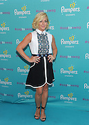 Actress and mom Jane Krakowski walks the teal carpet at the launch of the Pampers Cruisers #SagToSwag Tour in New York, Wednesday, Aug. 12, 2015.  The tour celebrates the new and improved Pampers Cruisers diapers which help prevent diaper sag, helping babies go from sag to swag.  (Photo by Diane Bondareff/Invision for Pampers/AP Images)