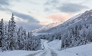 Morning light on the Chugach Mountains along Eagle River Valley in Southcentral Alaska. Winter.