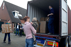 OUD-HEUSDEN, THE NETHERLANDS - FEB-23-2007 - <br /> Henry Diepeveen , his wife Ingrid and their sons Max, 6, and Niek, 2, are moving from their home in the Netherlands to Kobe, Japan where Mr. Diepeveen will work for the Dutch multi-national company Wartsila Propulsion B.V. Movers from De Haan Removals fill a shipping container with the Diepeveen's household belongings which will be shipped to Japan. (PHOTO / JOCK FISTICK)