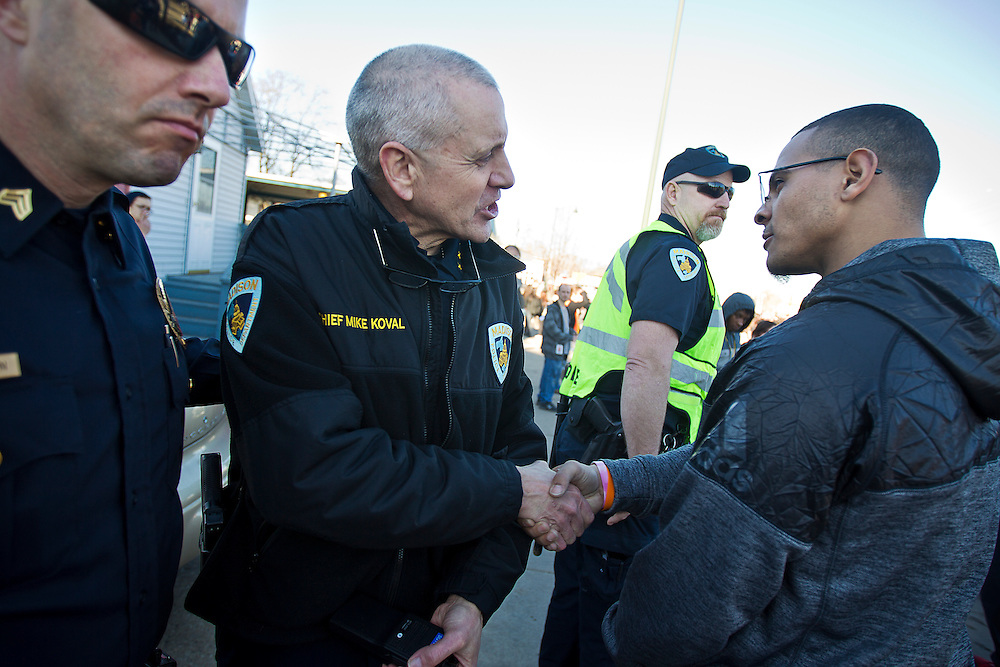 Madison Police Chief Mike Koval speaks with UW student Joshua Harrison during a protest in Madison, Wisconsin, March 11, 2015. Protestors rallied for the fifth day in a row, after the shooting death of Tony Robinson, Jr. by Madison Police inside his home on March 6, 2015. REUTERS/Ben Brewer (UNITED STATES)