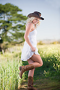 Cape Town model, Yolanda, wears cow girl clothes on the farm.