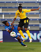 Martinique's Mandy Jacques, left, falls to the turf after going up for the ball against Jamaica's Sherona Forrester, right, during the first half of a CONCACAF Women's Championship soccer match, Thursday, Oct. 16, 2014, in Kansas City, Kan. (AP Photo/Colin E. Braley)
