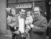 Image of Fianna Fáil leader Charles Haughey touring West Cork during his 1982 election campaign...04/02/1982.02/04/82.4th February 1982..Wooing voters of the future:..Children of the nation:..He poses here for a photograph with Peter Farrelly and his children, 4 year old Mark  and Lorna who is not yet 2.  The Farrelly family live in Bantry.