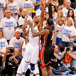 Jun 14, 2012; Oklahoma City, OK, USA; Miami Heat small forward LeBron James (6) shoots over Oklahoma City Thunder small forward Kevin Durant (35) during the fourth quarter of game two in the 2012 NBA Finals at Chesapeake Energy Arena. Mandatory Credit: Derick E. Hingle-US PRESSWIRE