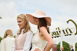 Left to right, DONNA AIR and GENEVIEVE GAUNTat the Cartier Queen's Cup Polo final at Guard's Polo Club, Smiths Lawn, Windsor Great Park, Egham, Surrey on 14th June 2015