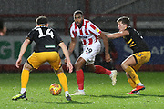Mark Harris, Tyrone Barnett and Charlie Cooper during the EFL Trophy match between Cheltenham Town and Newport County at LCI Rail Stadium, Cheltenham, England on 4 December 2018.