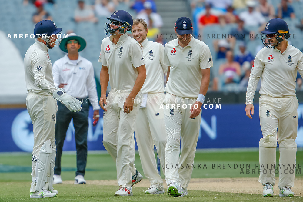 `England players share a laugh after Alastair Cook was hit in the groin while fielding in close during day 5 of the 2017 boxing day test.