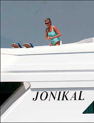 File photo of Lady Diana, Princess of Wales, with boyfriend Dodi Al Fayed spending their summer holiday in Saint-Tropez, south of France, on August 22, 1997. Princess Diana died on August 31, 1997 after suffering fatal injuries in a car crash in the Pont de l'Alma road tunnel in Paris. Her companion Dodi Fayed and driver and security guard Henri Paul were also killed in the crash. Photo by ABACAPRESS.COM  Diana of Wales Princesse Diana Princesse de Galles Diana de Galles Princess Diana of Wales Princess Diana Lady Dian Lady Diana Lady Di Princesse Diana de Galles Princess of Wales Bikini Swimwear Swimsuit Bikini Maillots de bain Deux-pieces Maillot de bain  | 594950_026 Saint-Tropez France