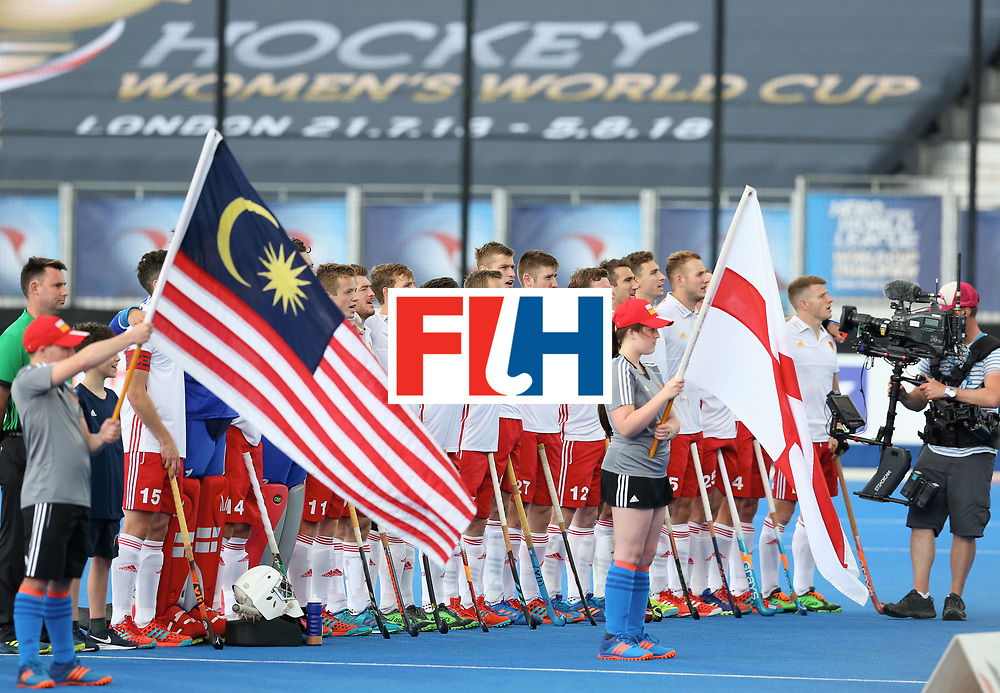 LONDON, ENGLAND - JUNE 25: England team sing the national anthem prior to the 3rd/4th place match between Malaysia and England on day nine of the Hero Hockey World League Semi-Final at Lee Valley Hockey and Tennis Centre on June 25, 2017 in London, England. (Photo by Steve Bardens/Getty Images)