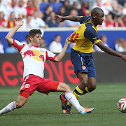 Abou Diaby, (right), Arsenal, is held by Ruben Bover, New York Red Bulls, during the New York Red Bulls Vs Arsenal FC,  friendly football match for the New York Cup at Red Bull Arena, Harrison, New Jersey. USA. 26h July 2014. Photo Tim Clayton