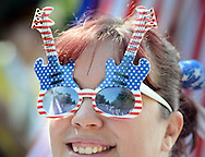 Claudia DiCrosta of Levittown, Pennsylvania wears twin guitar sunglasses in red, white and blue during the Middletown Township 4th of July Independence Day Parade Monday July 4, 2016 in Middletown Township, Pennsylvania. (Photo by William Thomas Cain)