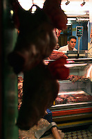 Pigs heads are displayed in a butcher shop in the barrio Ciudad Bolivar in southern Bogotá on Saturday, September 23, 2006. (Photo/Scott Dalton)