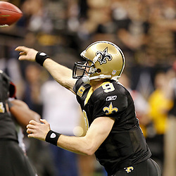 December 26, 2011; New Orleans, LA, USA; New Orleans Saints quarterback Drew Brees (9) throws a pass to break the NFL single-season passing record formerly held by Miami Dolphins quarterback Dan Marino on a 9-yard touchdown throw to Darren Sproles during the fourth quarter of a game against the Atlanta Falcons at the Mercedes-Benz Superdome. The Saints defeated the Falcons 45-16. Mandatory Credit: Derick E. Hingle-US PRESSWIRE