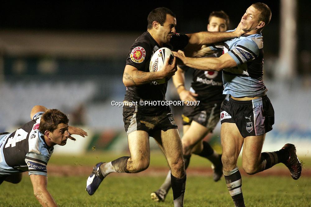 Wade McKinnon fends Adam Dykes.<br /> Sharks v Warriors. NRL.<br /> Toyota Park, Cronulla, Australia.<br /> Saturday 16 June 2007. <br /> Photo: Paul Seiser/PHOTOSPORT<br /> #NO COMMERCIAL USE#
