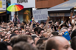 Old Compton Street, Soho, London, June 13th 2016. Thousands of LGBT people and their friends converge on Old Compton Street in London's Soho to remember the fifty lives lost in the attack on gay bar Pulse in Orlando, Florida. PICTURED: A defiant placard carries a simple message to those wishing to attack the LGBT community.