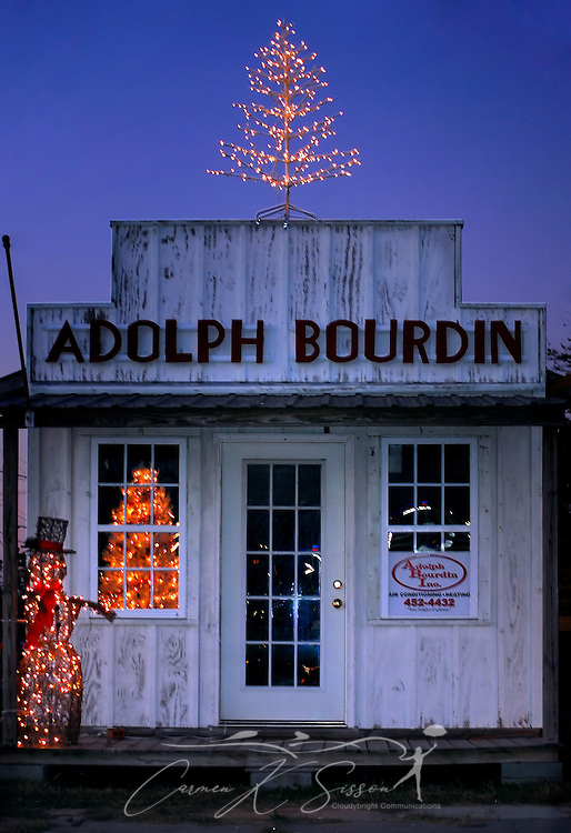 The offices of Adolph Bourdin Heating and Air Conditioning are decorated for Christmas on Market Street in Pass Christian, Mississippi on Dec. 8, 2010. (Photo by Carmen K. Sisson/Cloudybright)