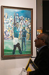 © Licensed to London News Pictures. 01/06/2016. Pele 1990 Birthday portrait painting by artist Maritimo with an estimate of £560-£840 from the Pele: The Collection with over 1,500 items of memorabilia owned by Pele for sale on later in June. London, UK. Photo credit: Ray Tang/LNP