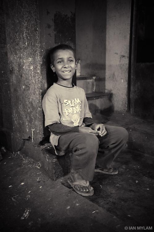Boy on a Step at Dusk - Bangalore, India