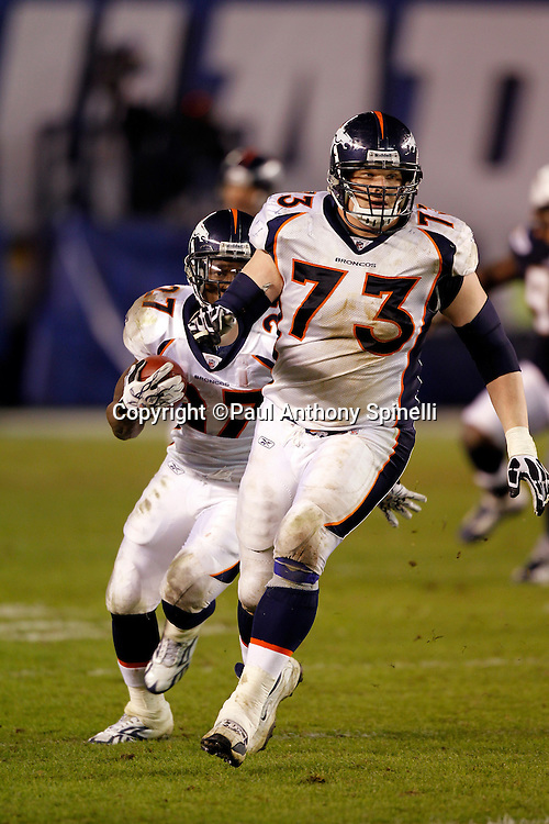 Denver Broncos guard Chris Kuper (73) lead blocks for Denver Broncos running back Knowshon Moreno (27) during the NFL week 11 football game against the San Diego Chargers on Monday, November 22, 2010 in San Diego, California. The Chargers won the game 35-14. (©Paul Anthony Spinelli)