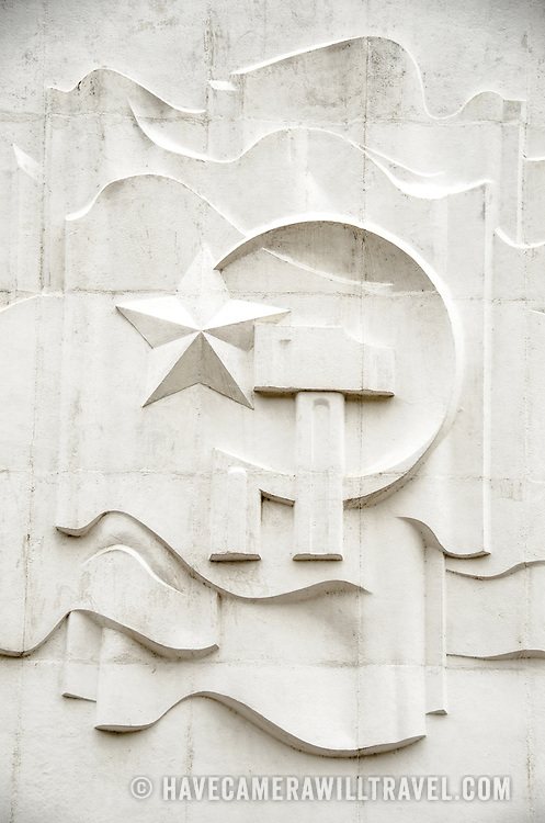 The communist symbol of a hammer and sickle etched into the wall above the main entrance of the Ho Chi Minh, or Uncle Ho, the former leader of North Vietnam and founder of modern unified Vietnam.