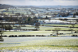 © Licensed to London News Pictures. 18/12/2011, London, UK.  A winter view towards Winter Hill. Canal boats in the frozen Leeds and Liverpool Canal, Central Lancashire, today 18 December. Photo credit : Stephen Simpson/LNP