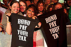 "© licensed to London News Pictures. Glastonbury Festival, UK. Crowd show off their Tshirts that say ""Bono Pay Yoor tax"". 24 June 2011. Please see special instructions for usage rates. Photo credit should read david Mirzoeff/LNP"