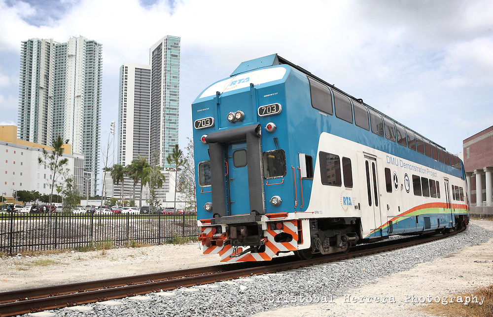 (CH)FL-Diesel-Multiple-Unit-Tren-CHc--Miami-Dade County Commission Chairman Joe A. Martinez is hosting a demonstration ride of a Diesel Multiple Unit (DMU) railcar in Downtown Miami on Wednesday, July 18, 2012. The DMU project seeks to utilize existing freight railroad lines to provide commuter rail service to different areas of the county and alleviate roadway congestion.  Staff photo/Cristobal Herrera Hialeah News