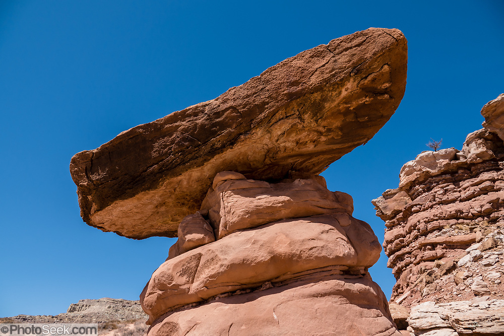 A balanced rock in Recapture Pocket, on BLM land, near Bluff, Utah, USA. The BLM (Bureau of Land Management) is part of the United States Department of the Interior.