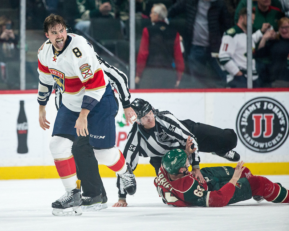 Dec 13, 2016; Saint Paul, MN, USA; Florida Panthers defenseman Dylan McIlrath (8) celebrates after a fight with Minnesota Wild forward Kurtis Gabriel (63) during the first period at Xcel Energy Center. Mandatory Credit: Brace Hemmelgarn-USA TODAY Sports
