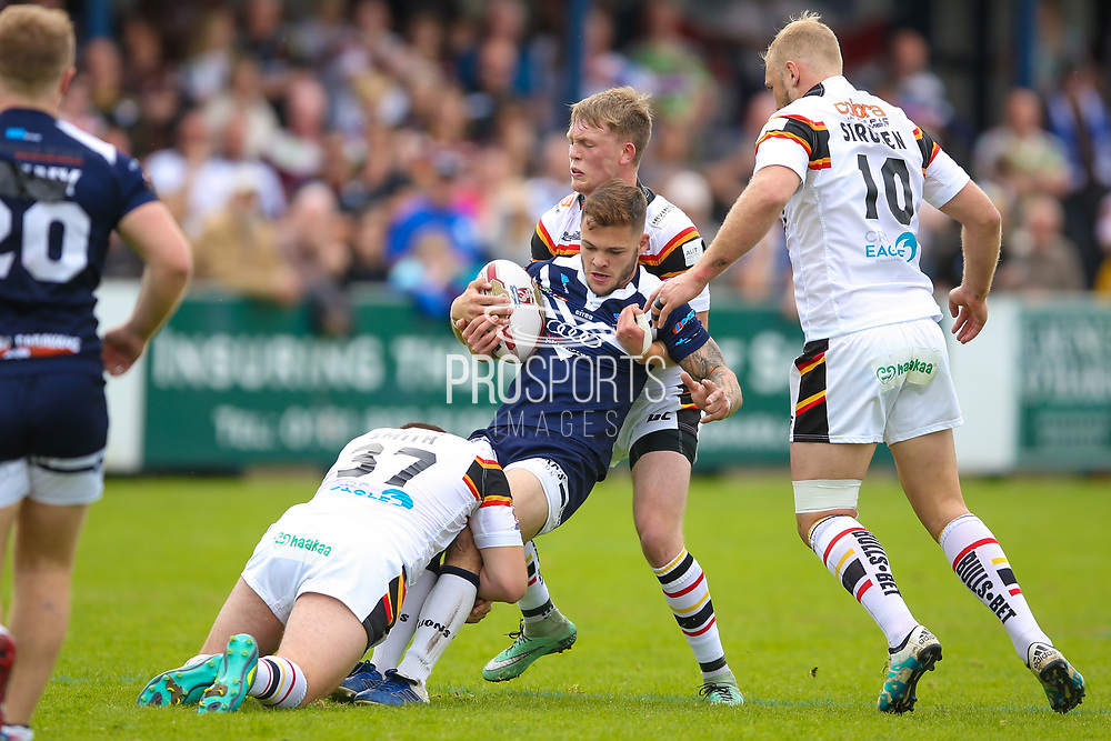 Bradford Bulls second row Cameron Smith (37) and Bradford Bulls scrum half Cory Aston (41) in the tackle  during the Kingstone Press Championship match between Swinton Lions and Bradford Bulls at the Willows, Salford, United Kingdom on 20 August 2017. Photo by Simon Davies.