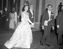 King Bhumibol Aduladej and Queen Sirikit of Thailand arriving at Lancaster House, London, for a dinner and reception given in their honour by Selwyn Lloyd, the Foreign Secretary.