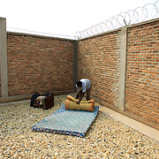 "A university student from Bujumbura University recovers his belongings at a community centre in Bujumbura, the day after the National Police dismantled their improvised camp outside the American embassy. The students moved to the area in early May because, they claim, the US authorities ensure their security, after their university was closed amid anti-government protests. The government closed the university at the end of April, citing ""insecurity""."