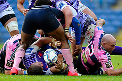 London Welsh Flanker (#7) Mike Denbee spills the ball after being tackled by Stade Francais Inside Centre (#12) Felipe Contepomi in the second half - Photo mandatory by-line: Rogan Thomson/JMP - Tel: Mobile: 07966 386802 13/10/2012 - SPORT - RUGBY - Kassam Stadium - Oxford. London Welsh v Stade Francais - European Challenge Cup