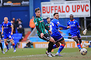 Aaron Amadi-Holloway shoots, Niall Canavan during the Sky Bet League 1 match between Oldham Athletic and Rochdale at Boundary Park, Oldham, England on 19 March 2016. Photo by Daniel Youngs.