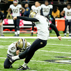 Oct 16, 2016; New Orleans, LA, USA; New Orleans Saints kicker Wil Lutz (3) connects of a 52 yard field goal with 16 seconds remaining in the fourth quarter of a win against the Carolina Panthers in a game at the Mercedes-Benz Superdome. The Saints defeated the Panthers 41-38. Mandatory Credit: Derick E. Hingle-USA TODAY Sports