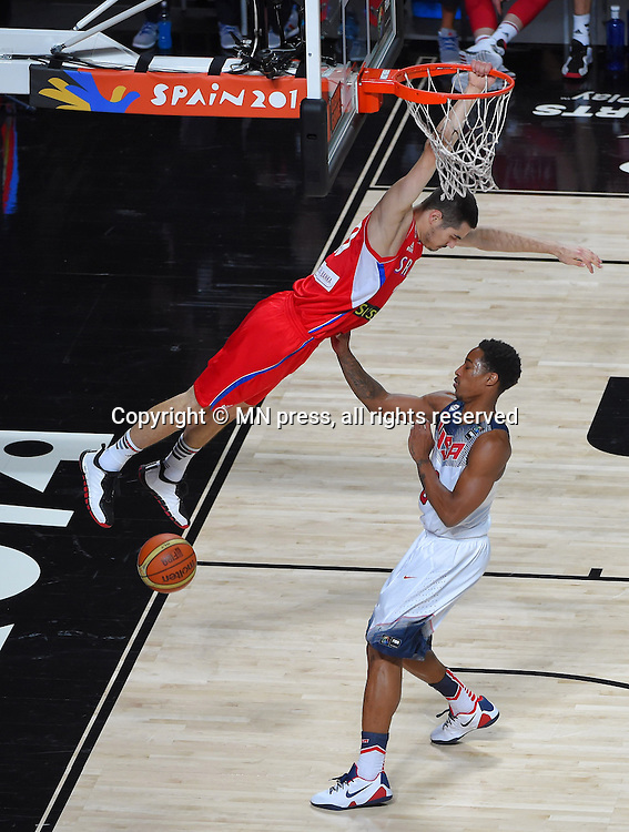 NIKOLA KALINIC of Serbia basketball team in action during Final FIBA World cup match against DEMAR DEROZAN of United states of America , Madrid, Spain Photo: MN PRESS PHOTO<br /> Basketball, Serbia, United states of America, Final, FIBA World cup Spain 2014