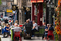 Edinburgh, Scotland, UK. 12 July, 2020, Business slowly returning to normal in Edinburgh city centre. Tourists still almost non existent and streets remain very quiet in the Old Town. Outdoor seating areas of pubs in the The Grassmarket are popular. Iain Masterton/Alamy Live News