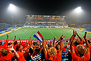 Dutch fans celebrate the 1-0 goal from the Netherlands during the preliminary pool B match against great Britain in the men's Field Hockey competition at the Beijing 2008 Olympic Games, Beijing, China, 13 August 2008. The Netherlands defeated Great Britain 1-0