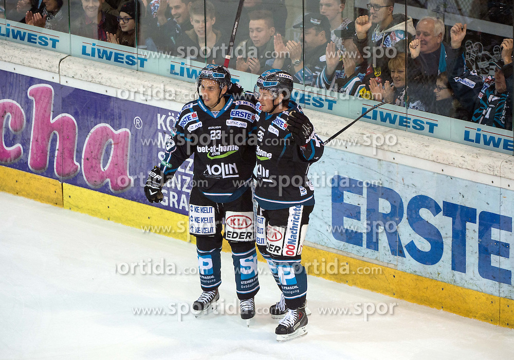 19.12.2014, Keine Sorgen Eisarena, Linz, AUT, EBEL, EHC Liwest Black Wings Linz vs Dornbirner EC, 28. Runde, im Bild Fabio Hofer und Rob Hisey (Liwest Black Wings Linz, #23, #26) feiern // during the Erste Bank Icehockey League 28th round match between EHC Liwest Black Wings Linz and Dornbirner EC at the Keine Sorgen Icearena, Linz, Austria on 2014/12/19. EXPA Pictures © 2014, PhotoCredit: EXPA/ Reinhard Eisenbauer