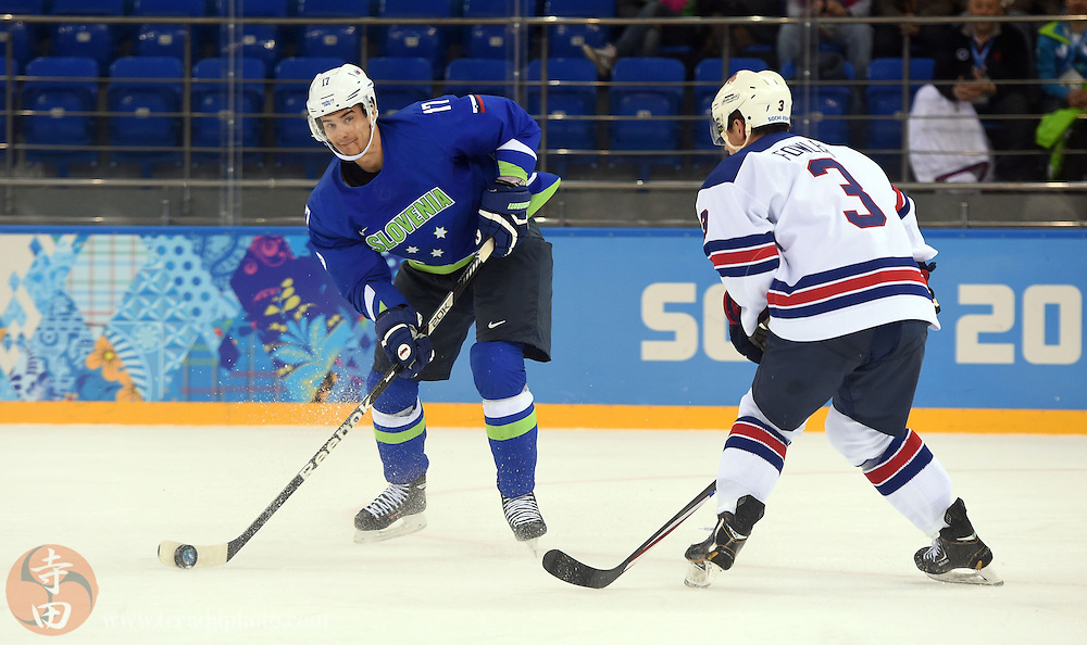 Feb 16, 2014; Sochi, RUSSIA; Slovenia defenseman Ziga Pavlin (17) passes the puck away from USA defenseman Cam Fowler (3) in a men's ice hockey preliminary round game during the Sochi 2014 Olympic Winter Games at Shayba Arena.