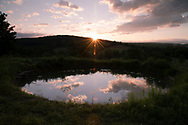Sunrise over a small pond at Firefly Farm, Hauverville, New York, U.S.A.